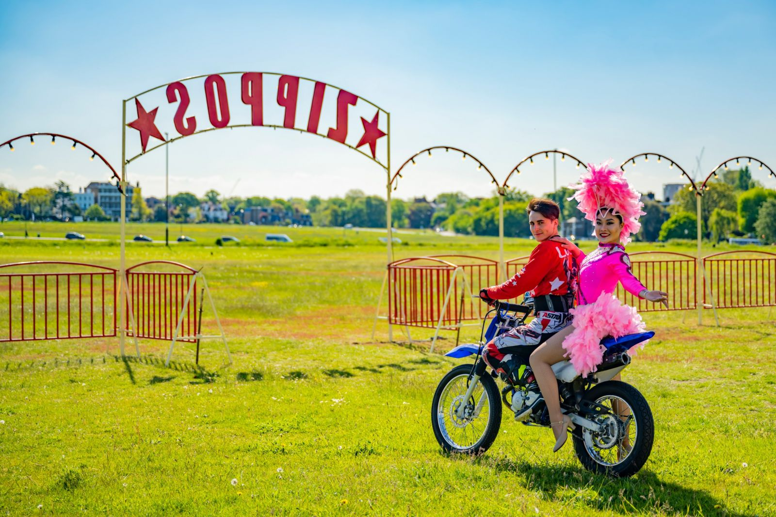 Showgirl and motorbike. Photographer credit: Piet-Hein Out
